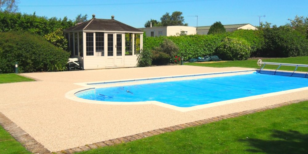 Resin bound swimming pool surrounds sureset for Swimming pool surrounds design